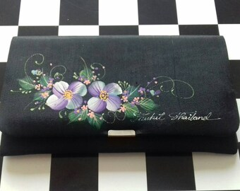 Black vintage purse with purple flowers from Phukett Thailand.