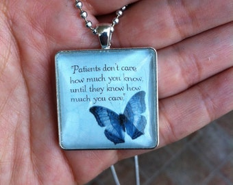 Caring for Patients Cabachon Silver Butterfly Necklace