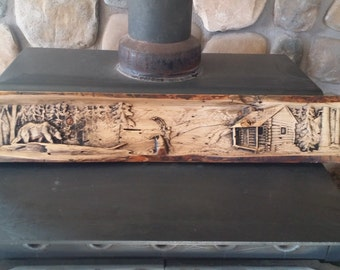 Grizzly,  fisherman, and cabin carved on rustic log slab