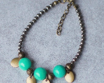 Green jade bracelet, pyrite and bronze