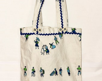 Handmade tote bag from Southern Madagascar.   Super cute.  Big buttons. Print of iconic Madagascar scenes.