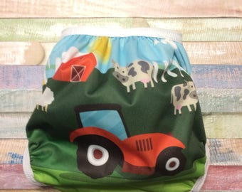 One Size On The Farm polyester pul waterproof cloth diaper cover with snaps or hook and loop.