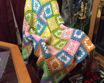 Multi colored granny square afghan blanket throw.
