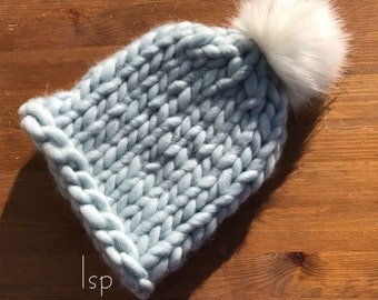 Hand knit rolled brim hat with pom pom