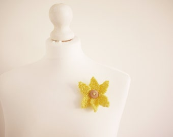 knitted yellow star flower brooch with wooden button detail