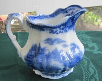 Small flow blue pitcher or creamer