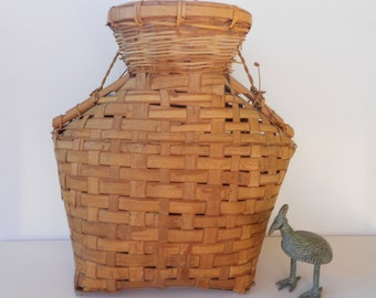 Old vintage basket in unusual shape with handle