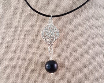 Black pearl and sterling silver scrollwork pendant necklace