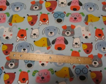Blue with Multicolor Dog/Puppy Faces Toss Flannel Fabric  by the Yard