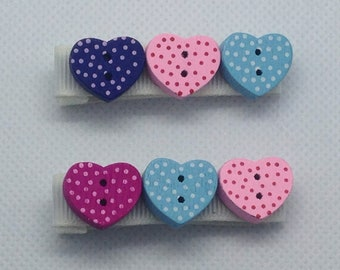 Pair of heart theme pink and blue crocodile clips.