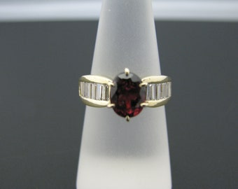 c810 Beautiful Ruby Ring in 14k Yellow Gold with CZ's down both sides