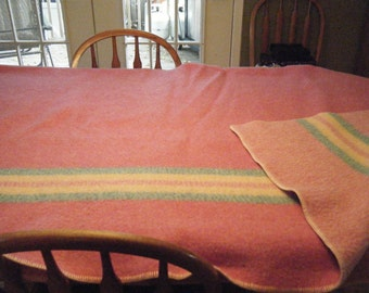 100% WOOL BLANKET in beautiful condition.  Pink with pastel stripes . Measures 60 by 80 inches.  Very clean..no matting or balls.