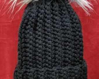Crochet cap with faux fur pom pom