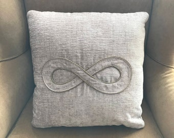 """Novelty Gray Gift Pillow with infinity symbol set in the center with piping.  18"""" x 18"""", Down Insert (90/10) included"""