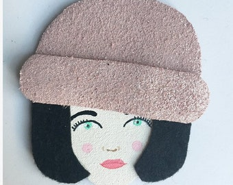 Brooch with bright pink leather Hat woman face