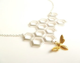 Honeycomb Necklace - gold brass bumblebee dangles from large bee hive pendant in matte silver on simple silver plated chain
