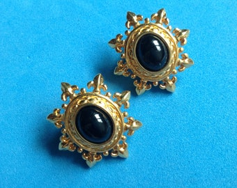 Monet gold tone & black clip on earrings! Vintage