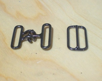 Bow tie hook and eye clasp with slide adjuster