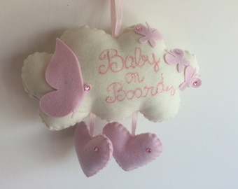 Baby on board a little cloud with butterflies and hearts