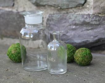 2 Glass Apothecary Bottles. Vintage. Antique Medicine Bottles, Clear. Mismatched. Pharmacy. Home Decor. Flower Vase. Lid. Storage Jar.