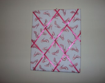 022 16x20 Pink Memory board with pink high heel shoes on it.