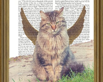 Winged Cat on repurposed Bible page