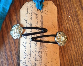 Two hair clips made with antique rhinestone buttons