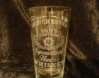 Winchester and Sons Supernatural Hunter Whiskey Etched Pint Glass Supernatural inspired pint glass Dean and Sam Winchester