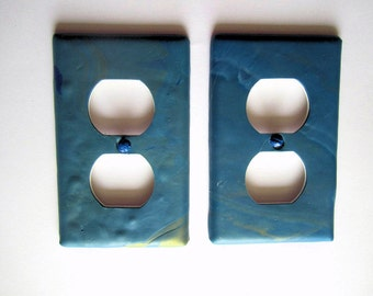 Outlet Cover in Shades of Blue with Gold Accent