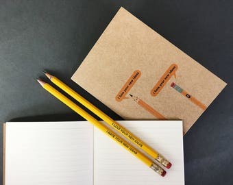 A pair of Love & Hate pencils