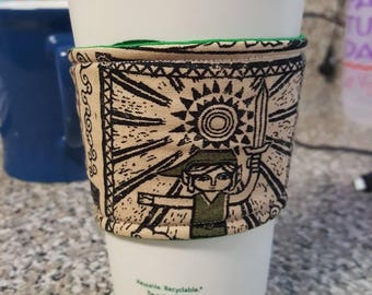 Legend of Zelda fabric coffee/tea Tall cup cozy. Beige and green. Pattern may vary due to the cut of fabric.
