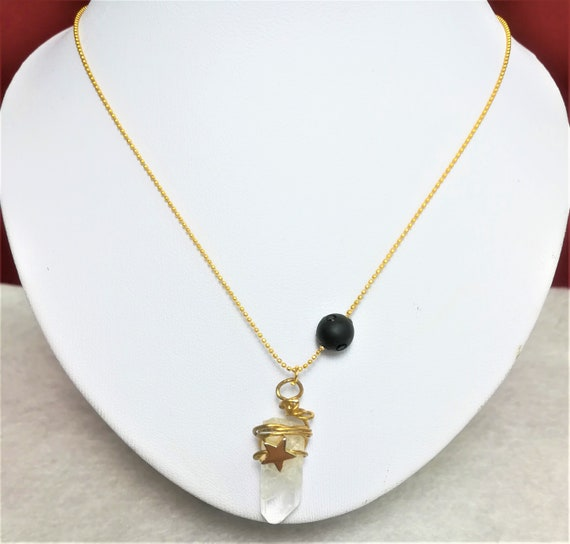 gold plated necklace with swarovski strassed pearl, gold plated star, tip of crystal rock pendant, gold plated chain and volute