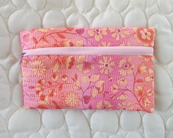Small clutch, make up case, pencil case, collector of stray items in your purse.