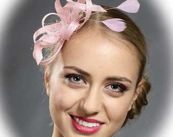 Pink small fascinator with matching feathers