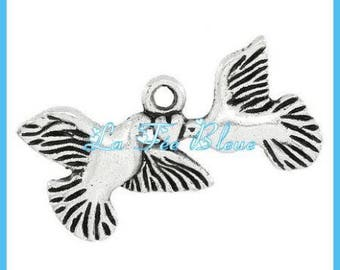 Doves holding a heart shaped pendant charm