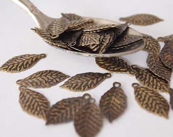 30 Metal Leaf Stampings Charms Leaf Shape Embossed Antique Brass Size 20 x 9mm Hole 1mm