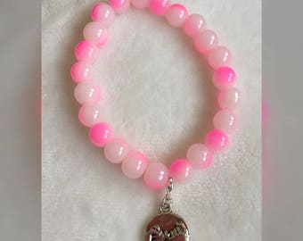 Pink beaded bracelet with pinky promise friendship charm