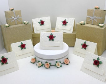 Place cards. Place settings. Cream tent style with embossed roses & 3d rose. Weddings. Anniversaries. Birthdays. Dinner parties. Elegant.