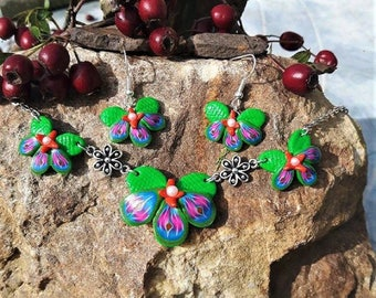 Green, blue and pink orchids set made of polymer clay.