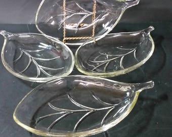 Vintage leaf shaped clear glass serving dishes. Set of 4