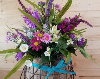 Purple wildflowers and Pink daisies  in a burlap and wire basket. Shabby chic Mothers Day Rustic