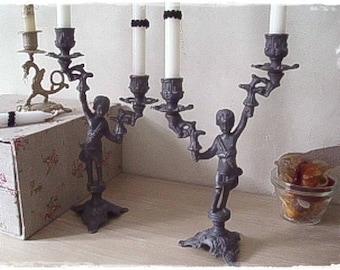 Cherub candlestick two branches