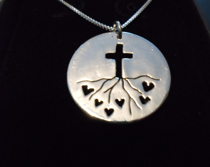 """Rooted in Love w/cross Quarter size w/18"""" sterling silver chain"""