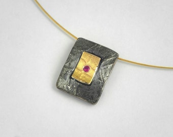 The switch! A rectangular gold and oxidized silver necklace with a genuine ruby and textured surface, Statement necklace, Textured pendant.