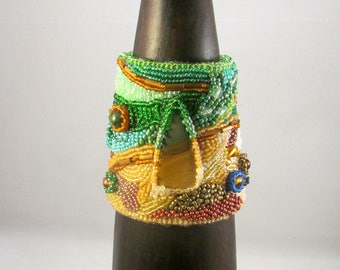 Beaded cuff bracelet with tiger's eye cabochon