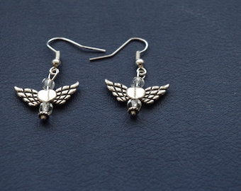 Delicate angel wing earrings compliment your angel bracelet.