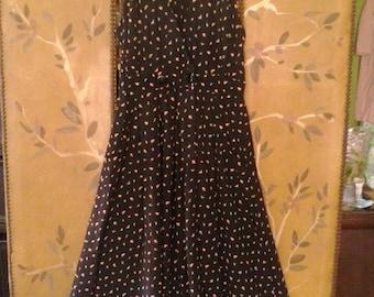 80s black floral sleeveless jumper/ maxi dress for R.J.Stevens by Carol Escritor