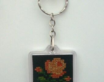 Square hand embroidered orange rose button