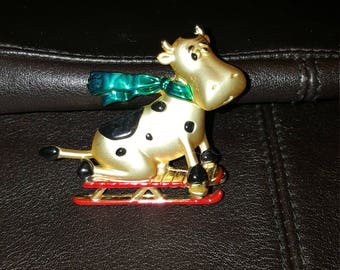 AJC collection holiday cow on sled pin