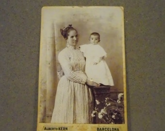 Old photograph, baby-sitting with child